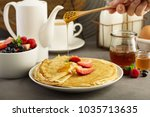 thin crepes with strawberry... | Shutterstock . vector #1035713635