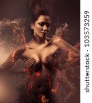 burning erotic sexy beautiful woman in dirty mist - stock photo