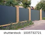 closed metal gate green and... | Shutterstock . vector #1035732721