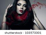 Woman In Black Hood With Smoke