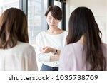 asian businesswomen talking in... | Shutterstock . vector #1035738709