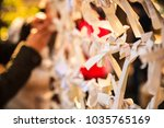 Small photo of Close-up view Group of Omikuji, a fortune telling paper strip, tied on the ropes with blurred background. People believe that leaving bad luck omen omikujis behind, it will turn to good luck instead.