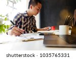 cropped shot of man working... | Shutterstock . vector #1035765331