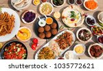 table full of delicious food | Shutterstock . vector #1035772621