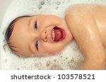 happy baby face in bubble bath - stock photo