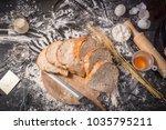 male baker prepares bread. male ... | Shutterstock . vector #1035795211