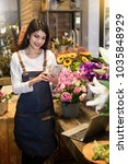florist standing at her flower... | Shutterstock . vector #1035848929