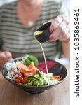 salmon nourish bowl for...   Shutterstock . vector #1035863461