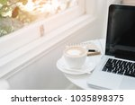 laptop with coffee cup home... | Shutterstock . vector #1035898375