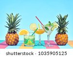 two pineapple with cocktail on... | Shutterstock . vector #1035905125