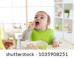 baby boy eating food in nursery ... | Shutterstock . vector #1035908251