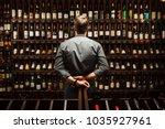 bartender at wine cellar full... | Shutterstock . vector #1035927961