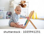cute little baby boy  playing... | Shutterstock . vector #1035941251