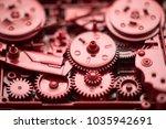 red gears and cogs macro shot ... | Shutterstock . vector #1035942691