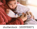 sick asian little child girl... | Shutterstock . vector #1035950071