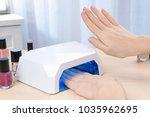 woman using uv lamp for... | Shutterstock . vector #1035962695