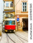 red vintage tram in the old... | Shutterstock . vector #1035985585