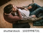pregnant woman with a husband... | Shutterstock . vector #1035998731