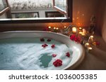 large filled bath with foam and ... | Shutterstock . vector #1036005385