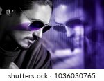 handsome guy in sunglasses with ... | Shutterstock . vector #1036030765