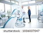 the dentist and patient's... | Shutterstock . vector #1036037047