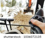Small photo of close up of hand operating heavy equipment excavator