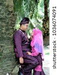 Small photo of malay bride and groom wearing malay traditional cloth