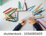 top view of little boy paints... | Shutterstock . vector #1036085605
