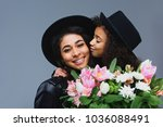 daughter kissing her mother... | Shutterstock . vector #1036088491