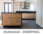 new kitchen in oak and black...   Shutterstock . vector #1036094461