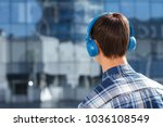 back view of young man in... | Shutterstock . vector #1036108549