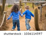 two cute little boy and girl... | Shutterstock . vector #1036114597