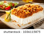 close up view of a crumbed fish ...   Shutterstock . vector #1036115875