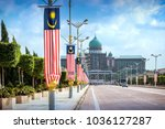 Small photo of View of the Prime Minister's office from the Seri Gemilang Bridge in the planned city of Putrajaya south of Kuala Lumpur with malaysian flags all along the road