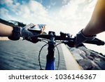 cyclist using smartphone for... | Shutterstock . vector #1036146367