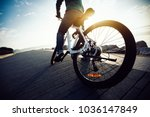 cyclist riding bike in the... | Shutterstock . vector #1036147849