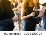 men and women hold a glass of... | Shutterstock . vector #1036150729