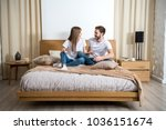 smiling couple talking and... | Shutterstock . vector #1036151674