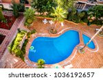 swimming pool in the tourist... | Shutterstock . vector #1036192657