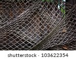 old fishing net hanging on reed ... | Shutterstock . vector #103622354