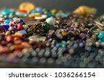 green gem ring on a pile of... | Shutterstock . vector #1036266154