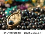 necklace on top of a stack of... | Shutterstock . vector #1036266184