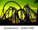 Silhouette Of A Roller Coaster...