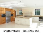 luxury fitted kitchen in... | Shutterstock . vector #1036287151