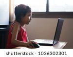 the asian girl works on a... | Shutterstock . vector #1036302301