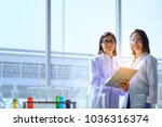 young female scientist standing ... | Shutterstock . vector #1036316374