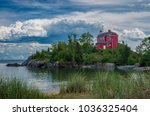 Small photo of The Marquette Harbor Light is located on Lake Superior in Marquette, Michigan. It is an active aid to navigation.