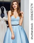 girl is buying a dress in the... | Shutterstock . vector #1036327174