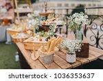 on wooden table in wedding... | Shutterstock . vector #1036353637