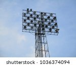 old floodlight mast in a... | Shutterstock . vector #1036374094